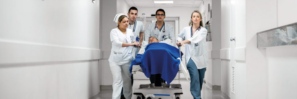 Photo of medical students moving a patient on a stretcher.