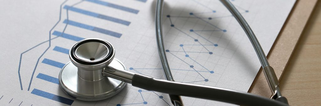 Stethoscope and sheet of paper with results