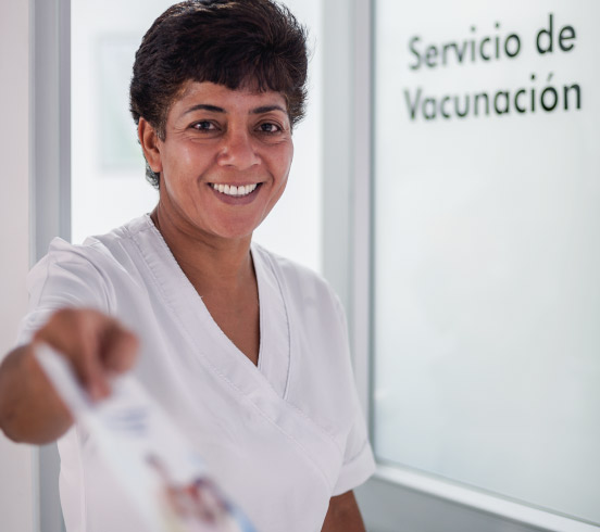 Photo of a nurse in front of the vaccination center