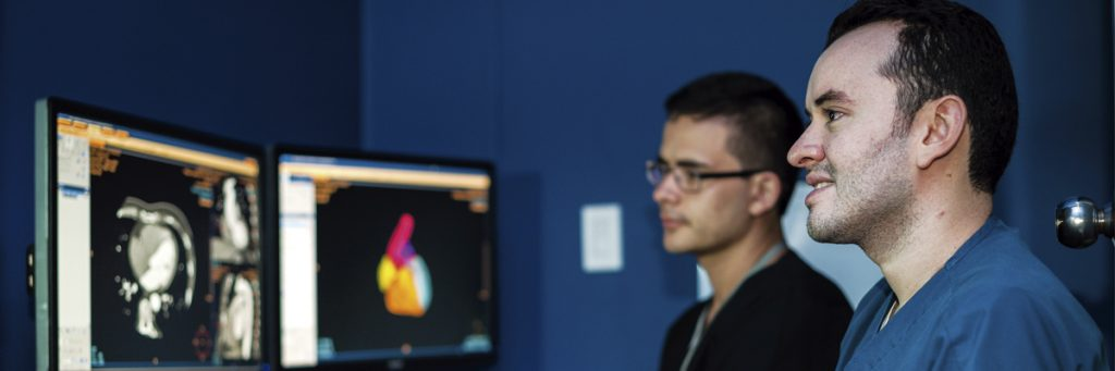 Resident photo accompanied by radiologist at an X-ray reading