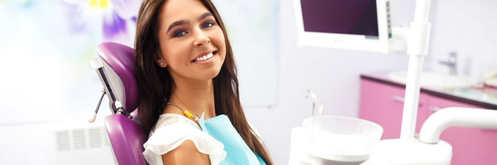 Patient photograph smiling in the dental chair while waiting to be cared for
