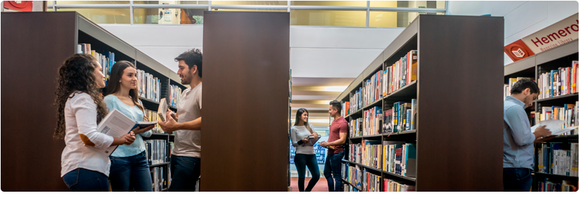 Photograph of students in the library enjoying the benefits between the CEs University and Consorcio Colombia