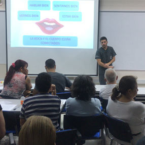 Photos of a dental student, giving talks on oral health