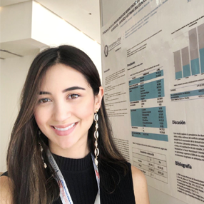 Photograph of resident María del Mar with her research poster