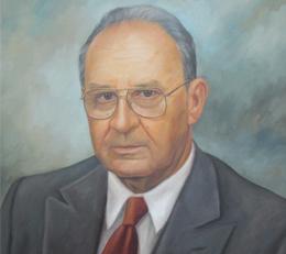 Pintura con el rostro del fundador Hernán Vélez