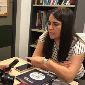 Teacher Gabriela Moreira Aguirre giving an interview