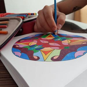Photograph of an employee coloring a mandala
