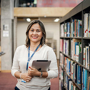 photo of the dean of nursing in a library
