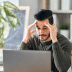 Image of stressed man in front of his computer
