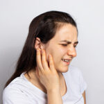 photograph of woman with earache