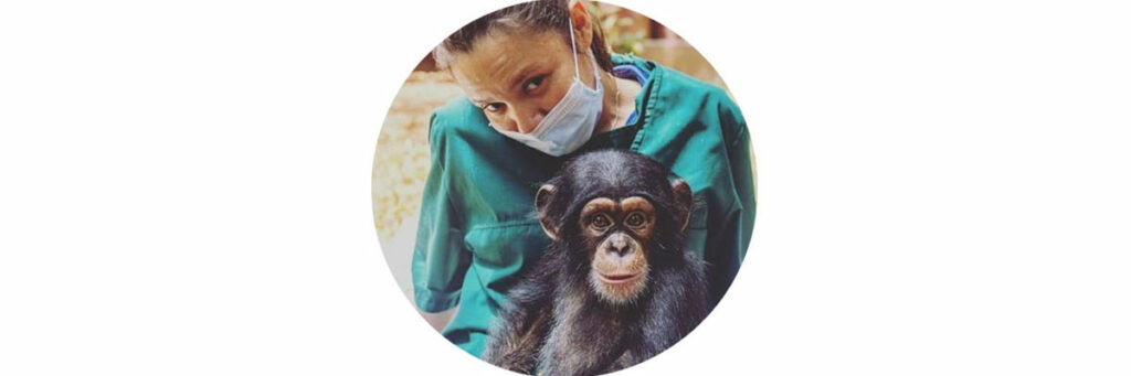 photograph of a woman carrying a chimpanzee